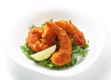 Deep fried shrimps on white plate Stock Image