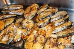 Deep fried slice king mackerel with fish sauce Stock Photos