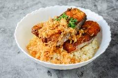 Deep fried sliced Pangasius fish with garlic stock image