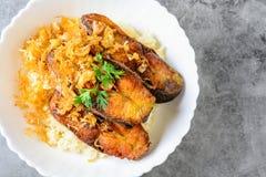 Deep fried sliced Pangasius fish with garlic royalty free stock photo
