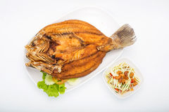 Deep Fried Snapper topped with Sweet Fish Sauce Royalty Free Stock Photography