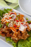 Deep fried soft shell crab. Modern Thai Food, Deep fried soft shell crab topped with sour and spicy herb salad Stock Image