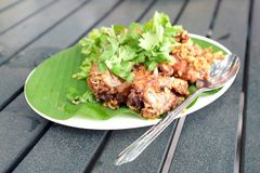 Deep fried soft shell crabs. With a stainless steel spoon on green leaf Royalty Free Stock Images