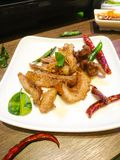 Deep Fried Spiced pork Neck with dried roasted chili and roasted kaffir lime leaves stock images