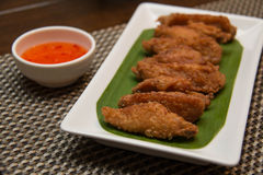 Deep fried spicy chicken wing with chili sauce Stock Photos