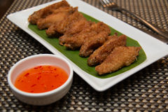 Deep fried spicy chicken wing with chili sauce Royalty Free Stock Photography