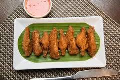 Deep fried spicy chicken wing with chili sauce Stock Images