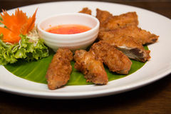 Deep fried spicy chicken wing with chili sauce Royalty Free Stock Photo