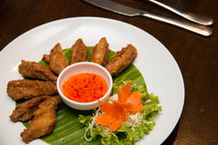 Deep fried spicy chicken wing with chili sauce Royalty Free Stock Images