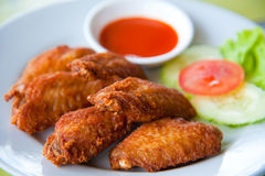 Deep fried spicy chicken wing with sauce Stock Images