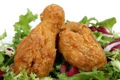 Deep fried spring chicken in golden lemon batter with salad Stock Image