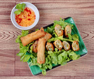 Deep fried spring roll  as four sheet wrap  fried vermicelli and sliced cabbage in roll bar to deep fried. Stock Images