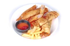 Deep fried spring roll,and frence fries sreved with tomato souce. Food for health,Deep fried spring roll as Por Peai J ,and frence fries sreved with tomato souce stock photography