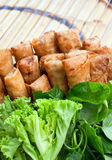 Deep fried spring rolls. And Vegetables on bamboo table Royalty Free Stock Photo