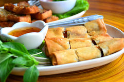 Deep fried spring rolls. Spring Rolls - Fried vegetable spring rolls served with sweet chili sauce Royalty Free Stock Image