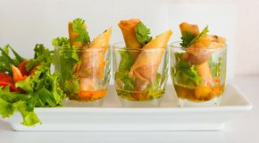 Deep fried spring rolls. With vegetable, sweet and sour sauce Stock Photos
