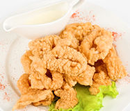 Deep-fried squid. With salad leaves, sauce, on a white background stock photography