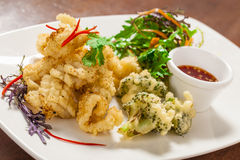 Deep fried squid. Szechuan pepper squid with nahm jim sauce Royalty Free Stock Photos