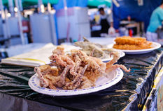 Deep fried squid at night market Royalty Free Stock Image