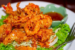 Deep fried squid rings. On the plate with salad Stock Photo