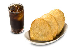 Deep fried stuffed pastry. Brazilian food pasteis on the backgro Stock Photography