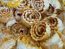Deep fried Ukrainian pastry treat. Traditional Ukrainian and Russian deep fried dessert pastry, called hvorost (brushwood), because of the crunch they produce royalty free stock photos