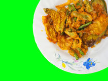 Deep fried vegetable, Thai style, on white dish, green die cut. Thai local traditional homemade food: golden yellow deep fried vegetable, cut string bean Stock Photography