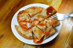 Deep fried Vietnamese pork sausage dipping ketchup stab on fork Royalty Free Stock Photo