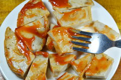 Deep fried Vietnamese pork sausage dressing tomato sauce stab on fork Stock Photography