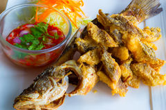 Deep fried whole sea perch with fish sauce Royalty Free Stock Photos