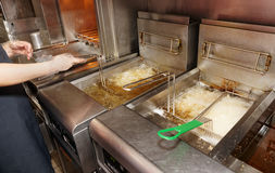 Deep fryer with boiling oil Stock Photography