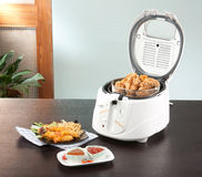 Deep fryer machine with chicken Stock Photo