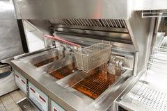 Deep fryer with oil. On restaurant kitchen Stock Photos