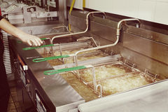 Deep fryers with boiling oil, toned image Stock Photo
