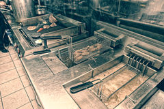 Deep fryers and grill, kitchen equipment, toned Stock Photos
