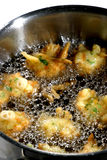 Deep-frying cod accras Stock Photography