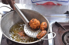 Deep frying pakora Stock Photo
