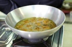 Deep frying pakoras in a wok Royalty Free Stock Photos