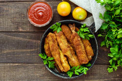 Free Deep Frying Small Fish Capelin In A Pan On A Dark Wooden Background. Stock Photography - 86725282