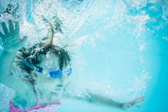In the deep - girl swimming underwater Stock Photography