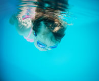 In the deep - girl swimming underwater Royalty Free Stock Photography