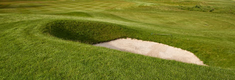 Deep golf bunker. On a summer golf course royalty free stock photography