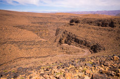 Deep gorge on Moroccan desert Stock Images