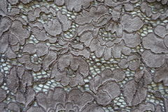 Deep gray guipure lacy fabric Royalty Free Stock Photo