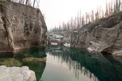 Deep Green Pool of still water in Meadow Creek Gorge in the Bob Marshall Wilderness area in Montana USA. Deep Green Pool of still water in Meadow Creek Gorge in stock image