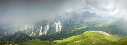 Deep hanging clouds above mountains. Mystic light breaks through fog. Deep hanging clouds above mountains and valley. Mystic light breaks through the fog Royalty Free Stock Photography