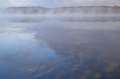 Deep Lake in Fog Stock Photo