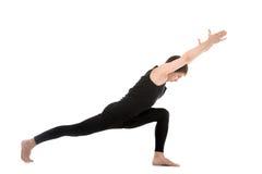 Deep lunge exercise, yoga asana Virabhadrasana I Stock Photography