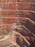 Deep mine hole in rock strata Royalty Free Stock Image