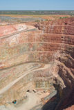Deep mine hole in rock strata Stock Images